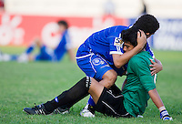 Eder Polanco (10) consoles teammate (1) Rolando Morales of El Salvador after the quarterfinals of the CONCACAF Men's Under 17 Championship at Catherine Hall Stadium in Montego Bay, Jamaica. The USA defeated El Salvador, 3-2, in overtime.