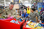Volunteer heroes help students shop during the 16th annual Holiday With a Hero shopping day, in Carson City, Nev., on Wednesday, Dec. 18, 2019. The event pairs law enforcement, fire, military and medical officials with homeless children from the Carson City School District McKinney-Vento program for a $100 shopping spree at Walmart.<br /> Photo by Cathleen Allison