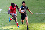 Oscar Ouma of Kenya (L) tries to put a tackle on Rocky Khan of New Zealand (R) during the HSBC Hong Kong Sevens 2018 Semi-Finals match between Kenya and New Zealand on April 8, 2018 in Hong Kong, Hong Kong. Photo by Marcio Rodrigo Machado / Power Sport Images