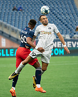 FOXBOROUGH, MA - APRIL 17: Hernan Gonzalez #19 of Richmond Kickers and Francois Dulysse #60 of New England Revolution II compete for a high ball during a game between Richmond Kickers and Revolution II at Gillette Stadium on April 17, 2021 in Foxborough, Massachusetts.