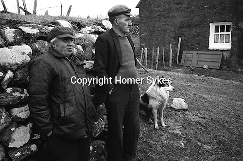 Isle of Lewis, two men and a sheep dog passing the time of day,  Carloway, Isle of Lewis and Harris,  Outer Hebrides, Scotland 1974