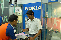 "Südasien Asien Indien IND Bombay , Handy Nokia Verkauf in Laden in Mumbai. -  Mobilfunk Mobiltelefon Kommunikation Telekommunikation xagndaz | .South Asia India Mumbai Bombay Nokia retailer shop.  -  communication mobile phone .| [ copyright (c) Joerg Boethling / agenda , Veroeffentlichung nur gegen Honorar und Belegexemplar an / publication only with royalties and copy to:  agenda PG   Rothestr. 66   Germany D-22765 Hamburg   ph. ++49 40 391 907 14   e-mail: boethling@agenda-fototext.de   www.agenda-fototext.de   Bank: Hamburger Sparkasse  BLZ 200 505 50  Kto. 1281 120 178   IBAN: DE96 2005 0550 1281 1201 78   BIC: ""HASPDEHH"" ,  WEITERE MOTIVE ZU DIESEM THEMA SIND VORHANDEN!! MORE PICTURES ON THIS SUBJECT AVAILABLE!! INDIA PHOTO ARCHIVE: http://www.visualindia.net ] [#0,26,121#]"