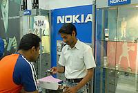"Südasien Asien Indien IND Bombay , Handy Nokia Verkauf in Laden in Mumbai. -  Mobilfunk Mobiltelefon Kommunikation Telekommunikation xagndaz | .South Asia India Mumbai Bombay Nokia retailer shop.  -  communication mobile phone .| [ copyright (c) Joerg Boethling / agenda , Veroeffentlichung nur gegen Honorar und Belegexemplar an / publication only with royalties and copy to:  agenda PG   Rothestr. 66   Germany D-22765 Hamburg   ph. ++49 40 391 907 14   e-mail: boethling@agenda-fototext.de   www.agenda-fototext.de   Bank: Hamburger Sparkasse  BLZ 200 505 50  Kto. 1281 120 178   IBAN: DE96 2005 0550 1281 1201 78   BIC: ""HASPDEHH"" ,  WEITERE MOTIVE ZU DIESEM THEMA SIND VORHANDEN!! MORE PICTURES ON THIS SUBJECT AVAILABLE!! INDIA PHOTO ARCHIVE: http://www.visualindia.net ] [#0,26,121#]"