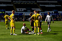 André Ayew of Swansea City goes down with an injury during the Sky Bet Championship match Swansea City and Wycombe Wanderers at Liberty Stadium in Swansea, Wales. Sporting stadiums around the UK remain under strict restrictions due to the Coronavirus Pandemic as Government social distancing laws prohibit fans inside venues resulting in games being played behind closed doors.<br /> Saturday 17 April 2021