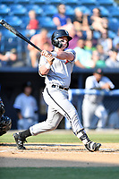 Kannapolis Intimidators catcher Evan Skoug (11) swings at a pitch during a game against the Asheville Tourists at McCormick Field on May 12, 2018 in Asheville, North Carolina. The Intimidators defeated the Tourists 11-8. (Tony Farlow/Four Seam Images)