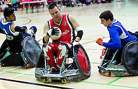 15 AUG 2011 - LEEDS, GBR - Canada's Mike Whitehead evades challenges from Great Britain's Mandip Sehmi (left) and David Anthony  (right) to score during the wheelchair rugby exhibition match between the two countries (PHOTO (C) NIGEL FARROW)