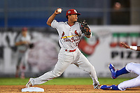 Palm Beach Cardinals shortstop Robelys Reyes (15) turns a double play during the second game of a doubleheader against the Dunedin Blue Jays on July 31, 2015 at Florida Auto Exchange Stadium in Dunedin, Florida.  Dunedin defeated Palm Beach 4-0.  (Mike Janes/Four Seam Images)