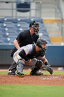 Umpire Louie Krupa and Bradenton Maruaders catcher Deon Stafford (37) during a Florida State League game against the Charlotte Stone Crabs on August 7, 2019 at Charlotte Sports Park in Port Charlotte, Florida.  Charlotte defeated Bradenton 2-0 in the first game of a doubleheader.  (Mike Janes/Four Seam Images)