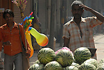 Street vendors selling watermelons and balloons in the Paharganj district of New Delhi, India.