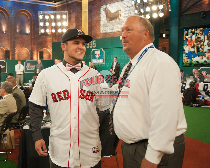 Infielder Michael Chavis (Sprayberry Senior  H.S. (GA)) the number 26 overall pick to the Boston RedSox with RedSox representatives Jim Woodward during the MLB Draft on Thursday June 05,2014 at Studio 42 in Secaucus, NJ.   (Tomasso DeRosa/ Four Seam Images)