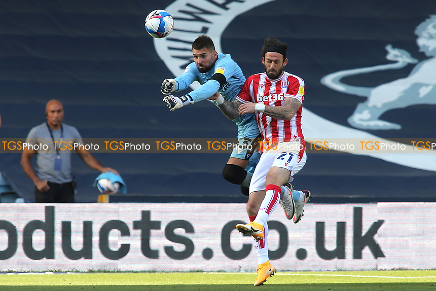 Millwall goalkeeper, Bartosz Bialkowski punches the ball clear under pressure from Steven Fletcher of Stoke City during Millwall vs Stoke City, Sky Bet EFL Championship Football at The Den on 12th September 2020