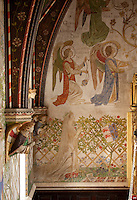 Arts and Crafts frescos in the chapel painted by Henry Payne and his young assistants, featuring angels and members of the Lygon family