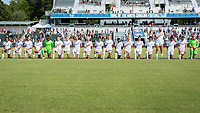 CARY, NC - SEPTEMBER 12: Portland Thorns starters and available substitutes all listen to the national anthem before a game between Portland Thorns FC and North Carolina Courage at WakeMed Soccer Park on September 12, 2021 in Cary, North Carolina.