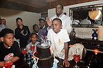 """Christian Combs, son of Sean """"P Diddy"""" Combs,  blows out the candles at Lavo restaurant, Las Vegas, NV, April 1, 2010 © Al Powers / RETNA ltd"""