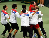 Members of the Serbian national tennis team celebrate after they have won the 2010 Davis Cup finals against France in Belgrade, Serbia, Sunday, Dec. 5, 2010. (Srdjan Stevanovic/Starsportphoto.com)