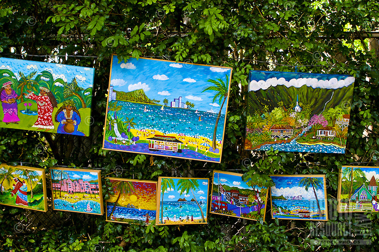 Local artist display their crafts along the sidewalk near the Honolulu Zoo in hopes for a sale to an interested island visitor.