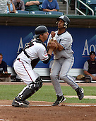 August 31, 2003:  Jake Fox of the Lansing Lugnuts, Class-A affiliate of the Chicago Cubs, upends Juan Francia during a Midwest League game at Oldsmobile Park in Lansing, MI.  Photo by:  Mike Janes/Four Seam Images