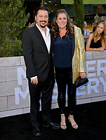 "LOS ANGELES, USA. June 11, 2019: James Vanderbilt & Amber Vanderbilt at the premiere of ""Murder Mystery"" at Regency Village Theatre, Westwood.<br /> Picture: Paul Smith/Featureflash"