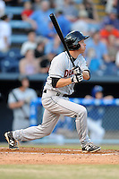 Delmarva Shorebirds second baseman Anthony Caronia #14 swings at a pitch during opening night game against the Asheville Tourists at McCormick Field on April 3, 2014 in Asheville, North Carolina. The Tourists defeated the Shorebirds 8-3. (Tony Farlow/Four Seam Images)