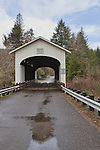 Wendling Covered Bridge, Circa 1938, over Mill Creek in Lane County Oregon.  Nearby Wendling and Marcola, Oregon.  Heavy rain passing.