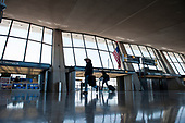 The morning hours are quiet at the international terminal at Dulles International Airport in Dulles, Va., Monday, March16, 2020. Some people are taking the precaution of wearing face masks as they arrive to be greeted by family and or friends. Credit: Rod Lamkey / CNP