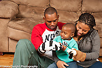 Toddler boy playing with his parents language development using hand puppets and talking