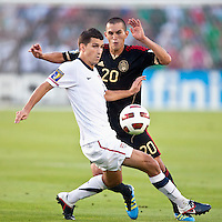 PASADENA, CA – June 25, 2011: USA player Eric Lichaj (14) and Mexican player Jorge Torres Nilo (20) during the Gold Cup Final match between USA and Mexico at the Rose Bowl in Pasadena, California. Final score USA 2 and Mexico 4.