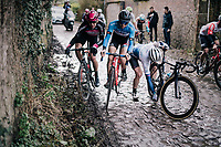 trying to avoid crashed rider Peter Williams (GBR/SwiftCarbon) over the slippery cobbles<br /> <br /> 51th Le Samyn 2019 <br /> Quaregnon to Dour (BEL): 200km<br /> <br /> ©kramon