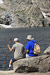 Father and son resting at Blue Lake in Indian Peaks Wilderness Area, west of Boulder, Colorado, USA.