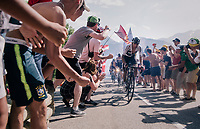 "Egan Bernal Gomez (COL/SKY) pilots yellow jersey Geraint Thomas (GBR/SKY) & Chris Froome (GBR/SKY) coming through ""Dutch Corner"" (#7) on Alpe d'Huez<br /> <br /> Stage 12: Bourg-Saint-Maurice / Les Arcs > Alpe d'Huez (175km)<br /> <br /> 105th Tour de France 2018<br /> ©kramon"