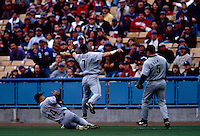 Derek Bell, Craig Biggio, and Jeff Bagwell of the Houston Astros participates in a Major League Baseball game at Dodger Stadium during the 1998 season in Los Angeles, California. (Larry Goren/Four Seam Images)