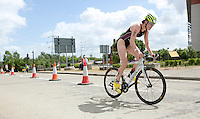 28 JUL 2013 - LONDON, GBR - Lucy Hall attempts to extend her lead on the bike during the Elite Women's race at the 2013 Virgin Active London Triathlon at Excel, Royal Victoria Dock in London, Great Britain (PHOTO COPYRIGHT © 2013 NIGEL FARROW, ALL RIGHTS RESERVED)