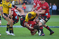 Cameron Roigard tackles George Bridge during the Super Rugby Aotearoa match between the Hurricanes and Crusaders at Sky Stadium in Wellington, New Zealand on Sunday, 11 April 2020. Photo: Dave Lintott / lintottphoto.co.nz