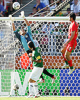 Mexican goalkeeper Oswaldo Sanchez reaches up for a cross. Mexico defeated Iran 3-1 during a World Cup Group D match at Franken-Stadion, Nuremberg, Germany on Sunday June 11, 2006.