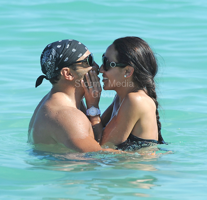 """SMG_FLXX_Melissa Gorga_Joe Gorga_Bikini_NYE_123111_01.JPG<br /> <br /> MIAMI BEACH, FL - DECEMBER 31: """"Real Housewives of New Jersey's"""" Melissa Gorga (sporting a sexy black two piece bikini) and her husband Joe share a kiss while playing in the water in South Beach.  on December 31, 2011 in Miami Beach, Florida  (Photo By Storms Media Group)  <br /> <br /> People:  Melissa Gorga_Joe Gorga<br /> <br /> Transmission Ref:  FLXX<br /> <br /> Must call if interested<br /> Michael Storms<br /> Storms Media Group Inc.<br /> 305-632-3400 - Cell<br /> 305-513-5783 - Fax<br /> MikeStorm@aol.com"""