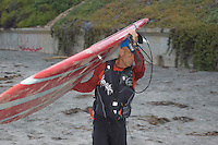 Tom Jones carries his 14ft paddleboard to the water at La Jolla Shores, California near Scripps Institution of Oceanography early on Saturday, November 3 2007.  Tom is set to become the first person to paddle the length of the California coast when his journey ends on Sunday at the Mexican border.  He hopes that his achievement will draw attention to the large amount plastic pollution in the oceans.