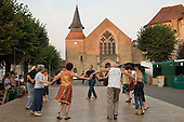 Local villagers dance in the village square during the 31st International Festival of Luthiers and Maitres Sonneurs, in Saint Chartier, France.