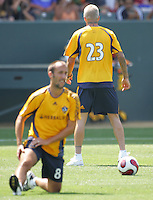 LA Galaxy midfielder Peter Vagenas (8) stretches in front of David Beckham during Beckhams first practice with the LA Galaxy at the Home Depot Center in Carson, California, Monday, July 16, 2007.
