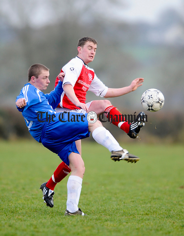 Kilrush's  Sean Downes contests a ball with Newmarket's Darren Cullinan during their Clare Junior Cup game in Newmarket. Photograph by John Kelly.