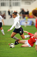 Carli Lloyd is tackled by the Norwegian defense. The USA defeated Norway 2-1 at Olhao Stadium on February 26, 2010 at the Algarve Cup.