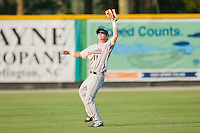 Shortstop Jonathan Merritt #11 of the Greeneville Astros catches a fly ball in shallow left field against the Burlington Royals at Burlington Athletic Stadium June22, 2010, in Burlington, North Carolina.  Photo by Brian Westerholt / Four Seam Images