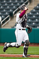 Luke Voit (30) of the Missouri State Bears heads to the dugout after being on defense during a game against the Oral Roberts Golden Eagles on March 27, 2011 at Hammons Field in Springfield, Missouri.  Photo By David Welker/Four Seam Images