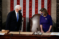 Speaker of the House Nancy Pelosi, D-Calif., and Vice President Mike Pence arrive to officiate as a joint session of the House and Senate convenes to count the Electoral College votes cast in November's election, at the Capitol in Washington, Wednesday, Jan. 6, 2021.<br /> Credit: J. Scott Applewhite / Pool via CNP/AdMedia