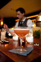 Slumdog Millionaire cocktail (foreground) served at Soda cocktail bar, Lyon, France, 13 January 2012