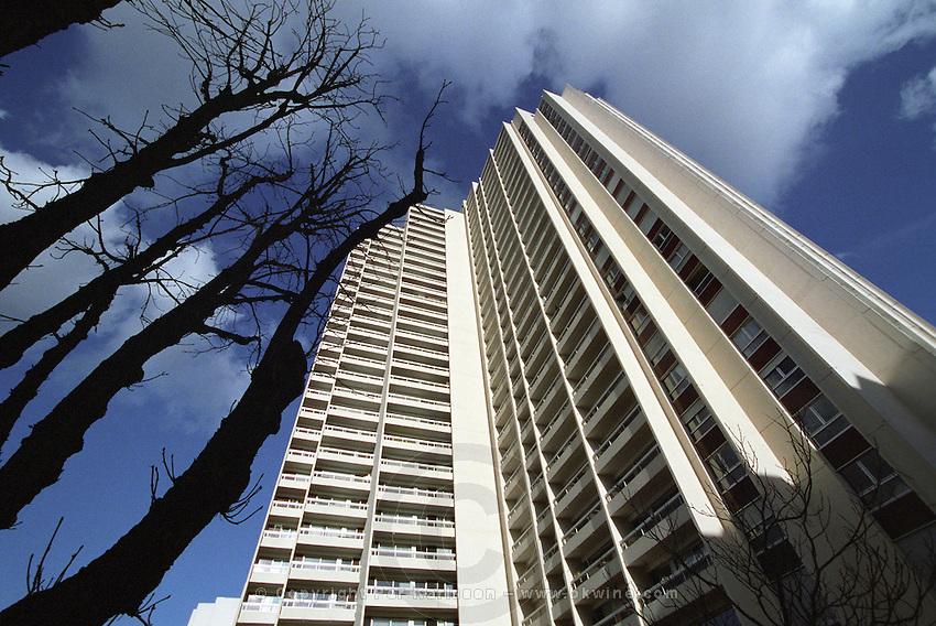 High rise apartment building in the Paris suburb Issy les Moulineaux. Leafless trees. Paris, France.