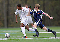 HYATTSVILLE, MD - OCTOBER 26, 2012:  Julian Dove (17) of DeMatha Catholic High School races away from Nate Johnson (19)of St. Albans during a match at Heurich Field in Hyattsville, MD. on October 26. DeMatha won 2-0.