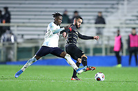 CARY, NC - DECEMBER 13: Bruno Lapa #10 of Wake Forest University is challenged by Irakoze Donasiyano #11 of University of Virginia during a game between Wake Forest and Virginia at Sahlen's Stadium at WakeMed Soccer Park on December 13, 2019 in Cary, North Carolina.