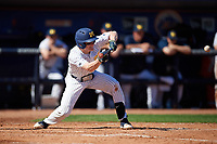 Michigan Wolverines shortstop Jack Blomgren (18) lays down a bunt during a game against Army West Point on February 18, 2018 at Tradition Field in St. Lucie, Florida.  Michigan defeated Army 7-3.  (Mike Janes/Four Seam Images)