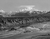 """""""The Tall One"""" <br /> Denali National Park, Alaska <br /> <br /> Denali stands 20,320 feet tall and is the highest mountain in North America. Denali reaches high enough into the atmosphere that it is claimed to create its own weather. This photo was taken from the south viewpoint on a clear morning when the only cloud in the sky was the one over Denali so I guess it may indeed create its own weather."""