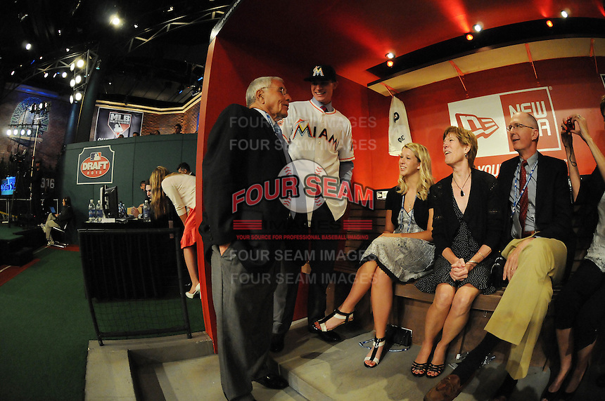 Pitcher Andrew Heaney (Oklahoma State) the number nine overall pick to the Miami Marlins and his family are greeted by Marlins Special Advisor to the Owner Jack McKeon during the MLB Draft on Monday June 04,2012 at Studio 42 in Secaucus, NJ.   (Tomasso DeRosa/ Four Seam Images)